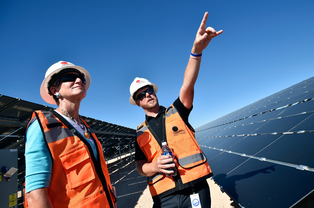 Secretary of the Interior Sally Jewel, left, tours the Moapa Southern Paiute solar project site with Geoffrey Dewhurst, project manager of First Solar Moapa, Thursday, Sept. 15, 2016, in Moapa. Je ...