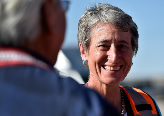 Secretary of the Interior Sally Jewel smiles as she speaks with tribal leaders before she tours the Moapa Southern Paiute solar project site, Thursday, Sept. 15, 2016, in Moapa. Jewel visited Firs ...