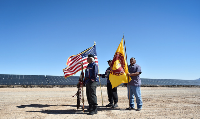 Dalton Tom, left, Harlan Bow and Greg Anderson prepare to take part in a flag presentation ceremony at the Moapa Southern Paiute solar project site, Thursday, Sept. 15, 2016, in Moapa. Secretary o ...