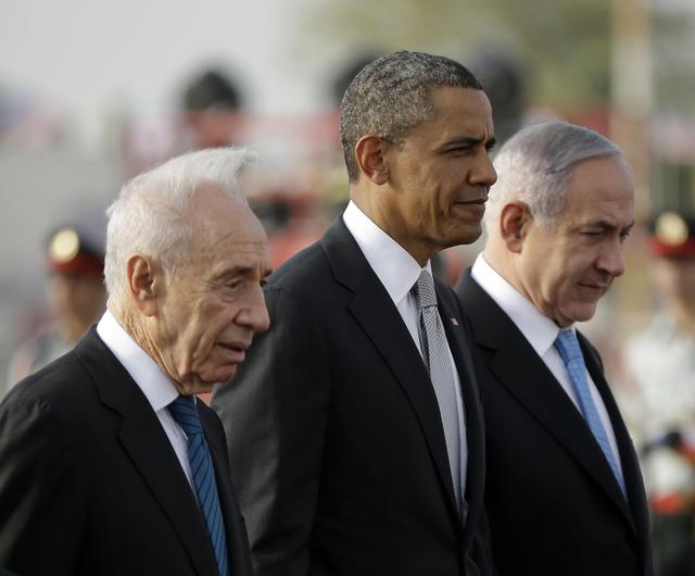 President Barack Obama walks with Israeli Prime Minister Benjamin Netanyahu, right, and Israeli President Shimon Peres, left, prior to his departure from Ben Gurion International Airport in Tel Av ...