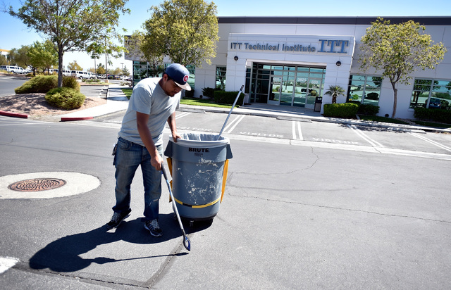 A maintenance worker cleans the parking lot in front of the   ITT Technical Institute Tuesday, Sept. 6, 2016, in North Las Vegas. The West Cheyenne Avenue campus along with 137 campuses across 39  ...