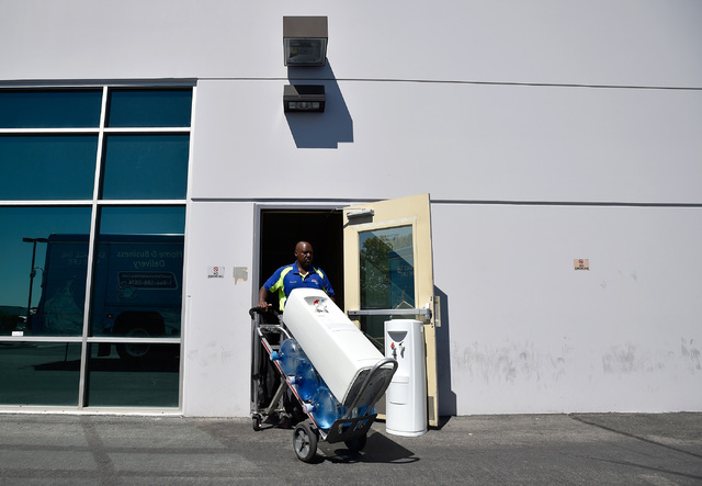 Knorval Ivy with Nestle Water retrieves water coolers from the now closed ITT Technical Institute school Tuesday, Sept. 6, 2016, in North Las Vegas. The West Cheyenne Avenue campus along with 137  ...