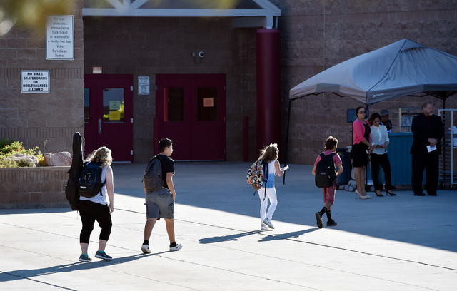 Students arrive at Johnson Junior High School Tuesday, Sept. 13, 2016, in Las Vegas. The school reopened after being closed for a mercury contamination cleaning since Thursday. David Becker/Las Ve ...