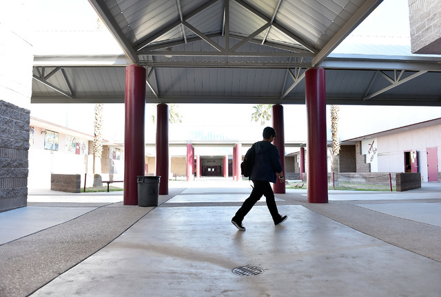 A student walks across the campus at Johnson Junior High School Tuesday, Sept. 13, 2016, in Las Vegas. The school reopened after being closed for a mercury contamination cleaning since Thursday. D ...