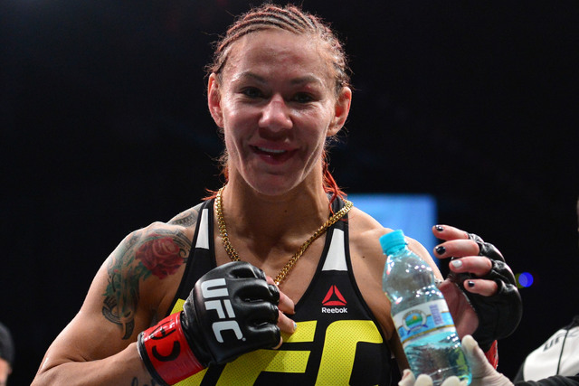 "Cristiane ""Cris Cyborg"" Justino is all smiles after beating Leslie Smith during UFC Fight Night in Brasilia, Brazil, on Friday, Sept. 23, 2016. (Jason Silva/USA TODAY Sports/Reuters)"