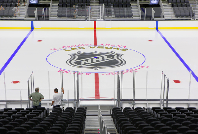 Daniel Pray, left, and Michael Feeney explore seating options during an open house for prospective 2017 Vegas NHL hockey season ticket holders at T-Mobile Arena Monday, Aug. 1, 2016, in Las Vegas. ...