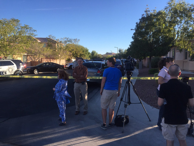 Media members gather near a barricade situation at the Far Hills-215 Beltway area in Summerlin, Sunday, Sept. 25, 2016. The Metropolitan Police Department said a person has barricaded himself in a ...