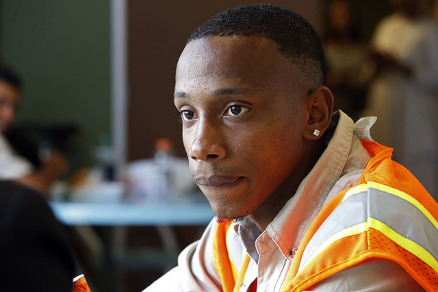 Lovis Bell, 23, talks about his own experience with the Los Angeles Police Department at a meeting in downtown Los Angeles Thursday, Sept. 15, 2016. (Reed Saxon/The Associated Press)