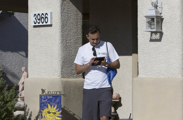Americans for Prosperity volunteer Roger Pattison updates his route while going door-to-door for the organization in a neighborhood in west Las Vegas on Monday, Aug. 29, 2016. (Richard Brian/Las V ...