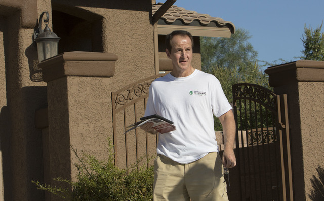 Tim Phillips, president of Americans for Prosperity, walks door-to-door while canvassing a neighborhood in west Las Vegas on Monday, Aug. 29, 2016. (Richard Brian/Las Vegas Review-Journal) Follow  ...
