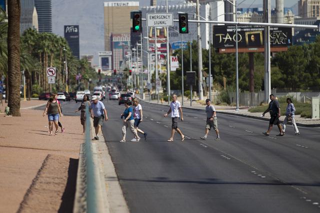 People cross Las Vegas Boulevard South toward the Welcome to Fabulous Las Vegas sign on Wednesday, Aug. 31, 2016, in Las Vegas. (Erik Verduzco/Las Vegas Review-Journal Follow @Erik_Verduzco)