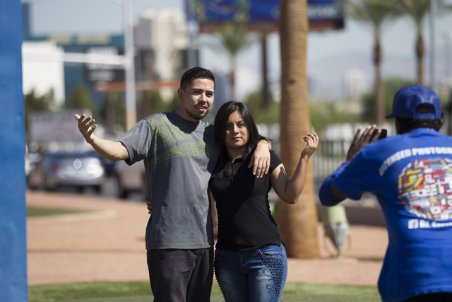 Irvin Suarez, left, and his girlfriend, Berenice Galeana, take a photo in front of the Welcome to Fabulous Las Vegas sign on Wednesday, Aug. 31, 2016, in Las Vegas. (Erik Verduzco/Las Vegas Review ...