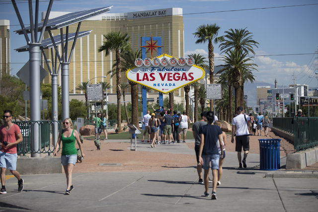 People take photos in front of the Welcome to Fabulous Las Vegas sign on Wednesday, Aug. 31, 2016, in Las Vegas. (Erik Verduzco/Las Vegas Review-Journal Follow @Erik_Verduzco)