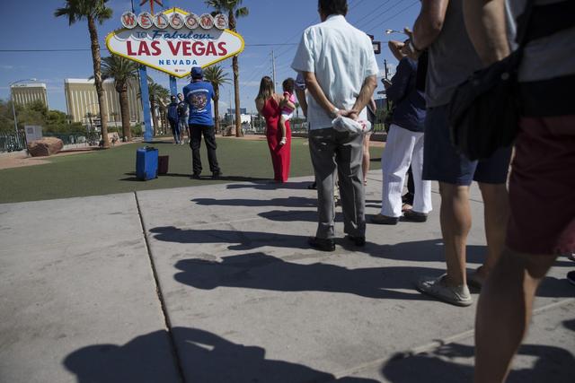 People line up to take a photo in front of the Welcome to Fabulous Las Vegas sign on Wednesday, Aug. 31, 2016, in Las Vegas. (Erik Verduzco/Las Vegas Review-Journal Follow @Erik_Verduzco)
