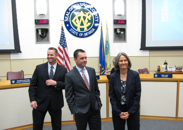 Dominic Brunetti, from left, Jesse Haw, and Julia Ratti prepare to talk to reporters after the Washoe County Commission appointed them to interim seats in the Nevada Legislature for an anticipated ...