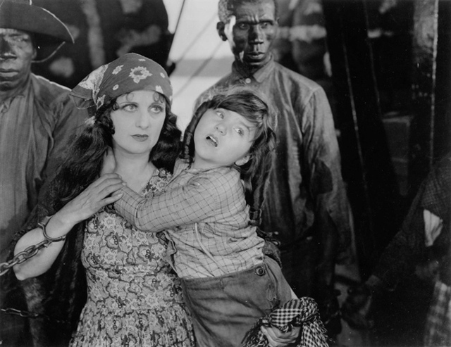 "Lassie Lou Ahern, right, plays Little Harry in the 1927 epic ""Uncle Tom's Cabin,"" her favorite of the many silents she made. (Courtesy Jeffrey Crouse)"