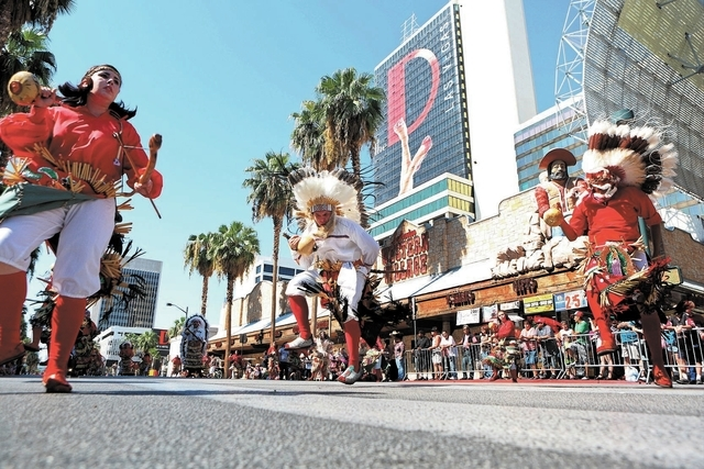 Matachines de Juarez (CQ) dancers perform during the Fiesta Las Vegas Latino Parade Saturday, Sept. 14, 2013, in Las Vegas. The parade, which traveled north on 4th Street downtown past the Fremont ...