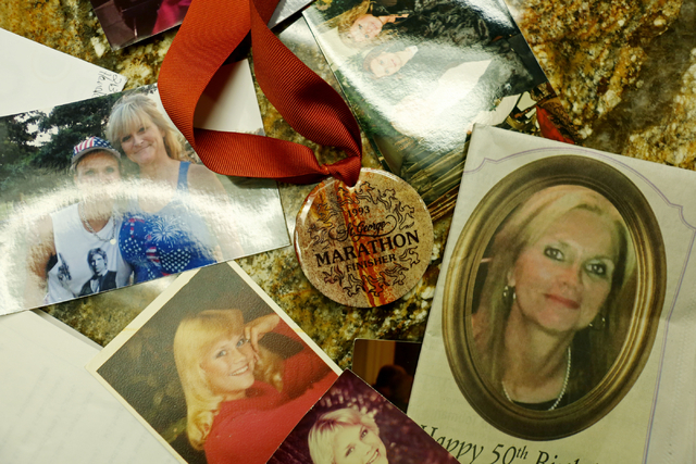 Photos of Susan Winters, along with a marathon medal, are scattered on a table at the law firm of Anthony Sgro on Sept. 7, 2016, in Las Vegas. (Elizabeth Page Brumley/Las Vegas Review-Journal Foll ...