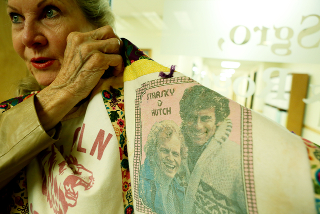 Avis Winters, mother of the late Susan Winters, holds a quilt made of Susan's favorite T-shirts from childhood at the law firm of Anthony Sgro, Wednesday, Sept. 7, 2016, in Las Vegas. (Elizabeth P ...