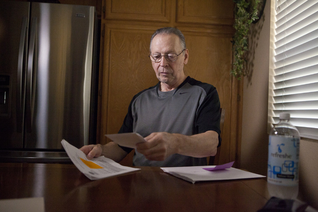 Marine veteran Richard Zaccara looks over his medical paperwork at his home in Henderson on Tuesday, Aug. 30, 2016. Zaccara was diagnosed with leukemia in 2003 as a result of being exposed to toxi ...