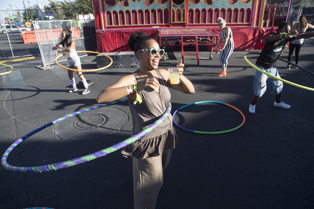 Krystal Hill hula hoops during the fourth annual Life is Beautiful music and art festival in downtown Las Vegas on Friday, Sept. 23, 2016. Loren Townsley/Las Vegas Review-Journal Follow @lorentownsley