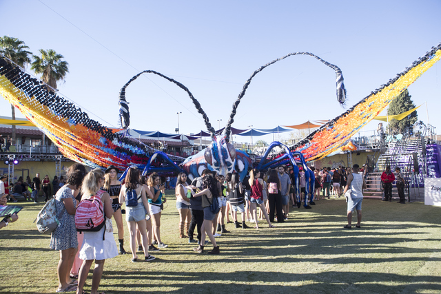 Attendees stand in front of an art installation during day one of the fourth annual Life is Beautiful music and art festival in downtown Las Vegas on Friday, Sept. 23, 2016. Loren Townsley/Las Veg ...