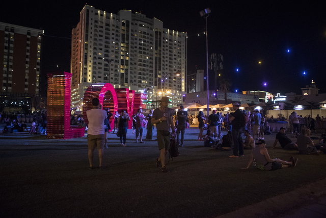 Attendees walk past an art installment during the fourth annual Life is Beautiful music and art festival in downtown Las Vegas on Friday, Sept. 23, 2016.Loren Townsley/Las Vegas Review-Journal Fol ...