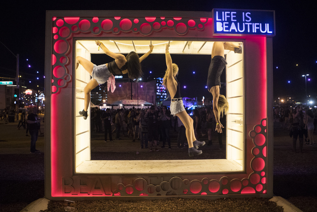Attendees hang from an art installment during the fourth annual Life is Beautiful music and art festival in downtown Las Vegas on Friday, Sept. 23, 2016.Loren Townsley/Las Vegas Review-Journal Fol ...