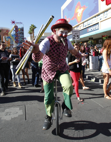 "A cast member of Cirque du Soleil show ""O"" entertains the crowd during the Life is Beautiful festival in downtown Las Vegas on Sunday, Oct. 27, 2013. (Chase Stevens/Las Vegas Rev ..."