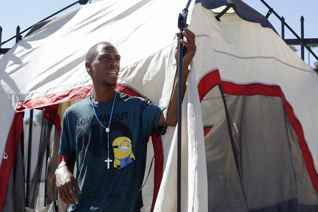 Mack Aron, who is homeless, fixes his tent on Monday, Sept. 19, 2016, on Foremaster Lane in Las Vegas. (Rachel Aston/Las Vegas Review-Journal) Follow @rookie__rae