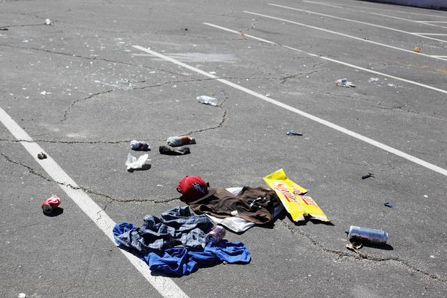 Pieces of debris are seen in a parking lot on Foremaster Lane in Las Vegas. (Rachel Aston/Las Vegas Review-Journal) Follow @rookie__rae