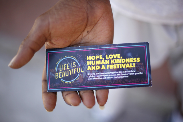 """Brigham Roberts holds his """"Golden Ticket"""" that he earned from the Life Is Beautiful organization for cleaning the streets on Monday, Sept. 19, 2016, on Foremaster Lane in Las Vegas. (Rachel Aston/ ..."""