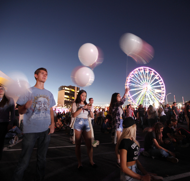 Max Johnson of Boulder City, left, and Adrienne Wo and Annette Wo, both of Henderson, listen to Broken Bells  at the Life is Beautiful festival in downtown Las Vegas on Sunday, Oct. 26, 2014. (Jus ...