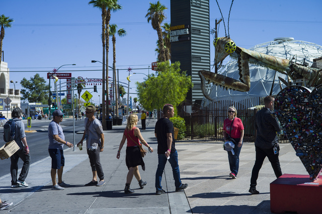 Zappos CEO Tony Hsieh, center, approaches the Container Park during the Life is Beautiful music and arts festival in downtown Las Vegas on Friday, Sept. 23, 2016. Chase Stevens/Las Vegas Review-Jo ...
