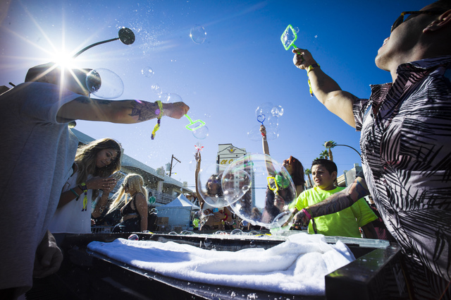 Attendees blow bubbles during the Life is Beautiful music and arts festival in downtown Las Vegas on Friday, Sept. 23, 2016. Chase Stevens/Las Vegas Review-Journal Follow @csstevensphoto