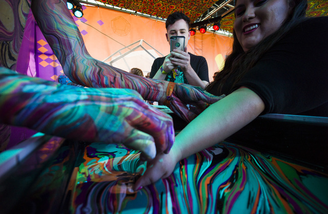 """Attendees try out """"hydro dipping"""" during the Life is Beautiful music and arts festival in downtown Las Vegas on Friday, Sept. 23, 2016. Chase Stevens/Las Vegas Review-Journal Fol ..."""