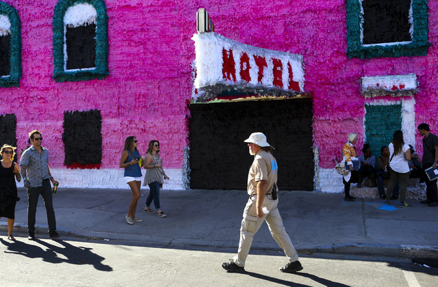 Attendees pass by an art installation during the Life is Beautiful music and arts festival in downtown Las Vegas on Friday, Sept. 23, 2016. Chase Stevens/Las Vegas Review-Journal Follow @csstevens ...