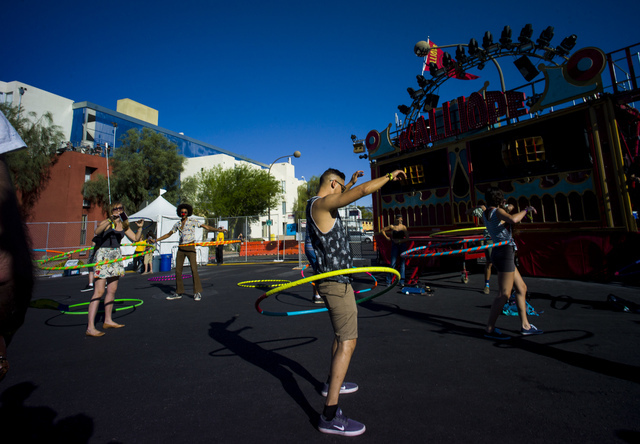 Attendees hula hoop during the Life is Beautiful music and arts festival in downtown Las Vegas on Friday, Sept. 23, 2016. Chase Stevens/Las Vegas Review-Journal Follow @csstevensphoto
