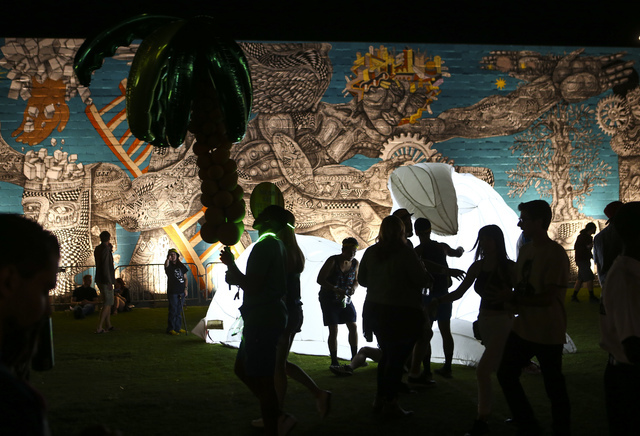 Attendees are silhouetted near an art installation and mural during the Life is Beautiful music and arts festival in downtown Las Vegas on Friday, Sept. 23, 2016. Chase Stevens/Las Vegas Review-Jo ...