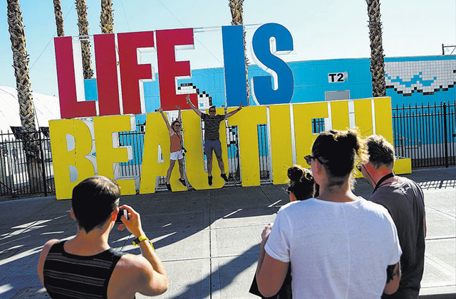Attendees pose for a photo during the Life is Beautiful music and arts festival in downtown Las Vegas on Friday, Sept. 23, 2016. Chase Stevens/Las Vegas Review-Journal Follow @csstevensphoto