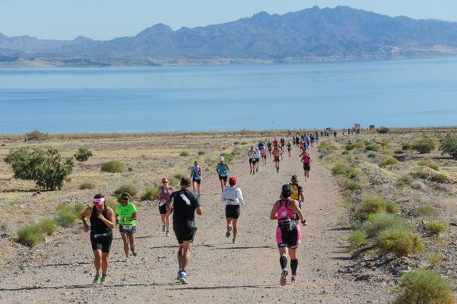 Participants run through the Lake Mead National Recreation Area as part of the Las Vegas Triathlon last year. (LVACtionImages.com)