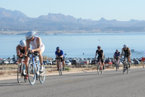 Participants cycle through the Lake Mead National Recreation Area as part of the Las Vegas Triathlon last year. (LVACtionImages.com)