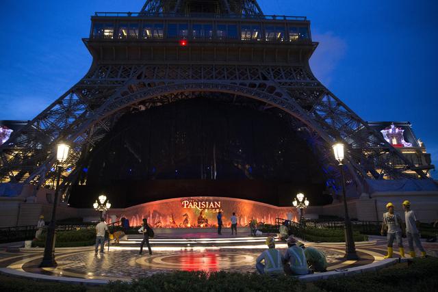 People walk in front of the half-scale Eiffel Tower at the Parisian Macau hotel-casino in Macau on Saturday, Sept. 10, 2016. The Parisian resort is set to open Tuesday. Erik Verduzco/Las Vegas Rev ...