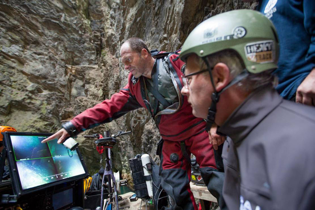 In this photo taken Sept. 27, 2016 in the flooded Hranicka Propast, or Hranice Abyss, in the Czech Republic Polish explorer Krzysztof Starnawski, left, and Bartlomiej Grynda, right, are reading im ...