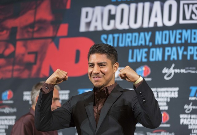 Jessie Vargas poses for photographers during a news conference about his upcoming boxing bout against Manny Pacquiao, in Beverly Hills, Calif., on Thursday, Sept. 8, 2016. The WBO welterweight tit ...