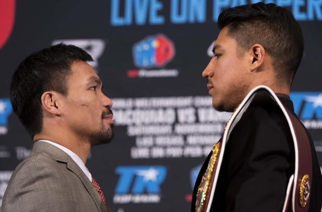 Manny Pacquiao, left, and Jessie Vargas face each other during a news conference in Beverly Hills, Calif., on Thursday, Sept. 8, 2016., about their WBO welterweight title fight scheduled for Nov.  ...