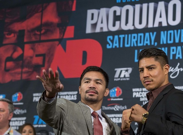 Manny Pacquiao, left, and Jessie Vargas poses for photos during a news conference in Beverly Hills, Calif., on Thursday, Sept. 8, 2016., about their WBO welterweight title fight scheduled for Nov. ...