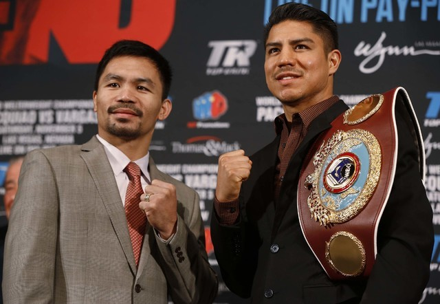 Manny Pacquiao, left, and Jessie Vargas pose during a news conference in Beverly Hills, Calif., on Thursday, Sept. 8, 2016, about their WBO welterweight title fight scheduled for Nov. 5. (Damian D ...