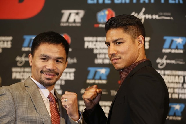 Boxers Manny Pacquiao, left, and Jessie Vargas pose during a news conference in Beverly Hills, Calif., on Thursday, Sept. 8, 2016, about their WBO welterweight title fight scheduled for Nov. 5. (D ...