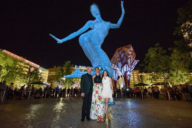 Sculptor Marco Cochrane and his wife, Julia Whitelaw, flank Deja Solis, his childhood friend and the inspiration for his sculpture Bliss Dance, at The Park on the Las Vegas Strip. (Barry Toranto)